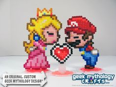 Super Mario & Princess Peach Kissing Wedding Cake Toppers by Geek Mythology… Perler Beads, Hamma Beads 3d, Perler Bead Mario, Fuse Beads, Pixel Beads, Super Mario Princess, Mario And Princess Peach, Pixel Art, Gamer Wedding Cake