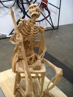 Carved Skeleton Sculpture