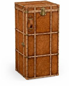 """The Jonathan Charles 494487 Drinks Cabinet comes in Leather Antique Chestnut Medium finish, is from the Voyager Collection and measures 22.99W x 22.99D x 48.03H inches. Oak and brass bound travel trunk style wine and cocktail cabinet with hinged lid. Front panel lined with glass storage and shelves within for bottle racking. Patinated brass fittings and antiqued """"labels"""" to exterior."""