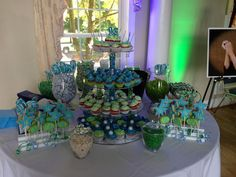 Blue, green and bling sweet 16 cupcake tower and cookie pops...