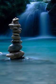 Serenity.....in the flow of the river....as it streams past the river rocks....