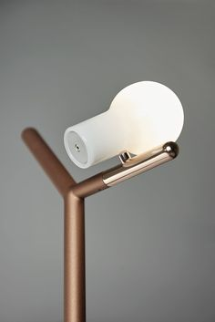http://design-milk.com/gyro-introduces-myna-a-floor-lamp-and-coat-rack-in-one/