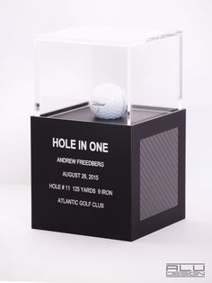 Modern HOLE IN ONE Display Golf Ball Display Cases CNC Machined Anodized Aluminum Black with graphite carbon Fiber Design. Golf Trophy Cases, Hole In One Plaques. Modern Golf Displays and Trophies. Made in the USA. Order on our website shipping worldwide. ALUDESIGNUS Golf Display luxury golf accessories #Ace #HoleinOne #Holein1 Atlantic Golf Club
