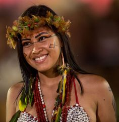 A Pataxo woman participates in a parade called 'Kuña Porã' (Beautiful woman in Guarani language) during the first World Games for Indigenous Peoples. Brazil 2015 by Marcelo Camargo