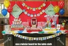Bridgey Widgey: Game Night Party: behind the scene...twister tablecloth, game pieces as decor