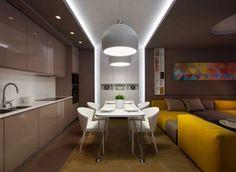 Beige Küchenzeile, Weiße Esszimmermöbel Und Gelbes Sofa