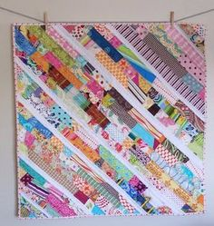 Versatile, simple patterns for scrap quilts can be hard to find, but this Scatter Sunshine Baby #Quilt is the perfect quilt #pattern for all of your smallest scraps. Intersperse strips of scraps with white strips to give this quilt a brighter feel.