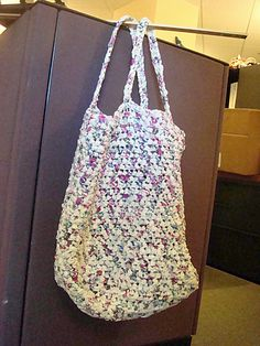 Reusable shopping bag made from plastic grocery bags. Wish i knew how to crochet.