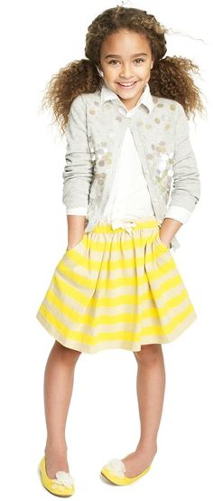 Gray sequin cardi, yellow striped skirt.