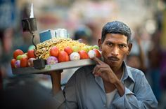 Street vendor carries a plate of vegetables in Jaipur Rajasthan. Photo by Inzane