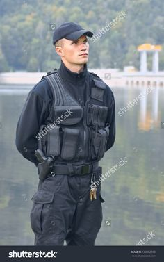 stock-photo-security-guard-in-uniform-and-armed-162052598.jpg (1000×1600)