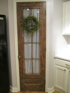 repurposed pantry door | For the Home / Our new pantry door made from an old antique door caked ...