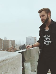 Our boy, Liam, hanging out in the new Wild Life tank paired w/ black Levi's and Converse