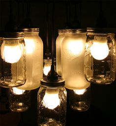 DIY Mason Jar Chandelie  Mason jars! Is there anything they can't do? From beautiful solar-powered lanterns for your back yard to whimsical lights for your home, to the mason jar light fixtures Allison showed us earlier today, these jars have many uses and you should always strive to keep them around, even if it's just to keep some food in them.