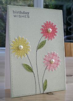die cut flowers, hand cut leaves, a stamped sentiment and some simple stitching - bjl