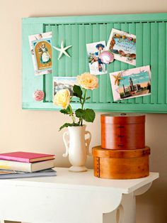 Paint an old shutter with the accent color for each property (turquoise, coral, sea glass green) and decorate with vintage or San Diego postcards
