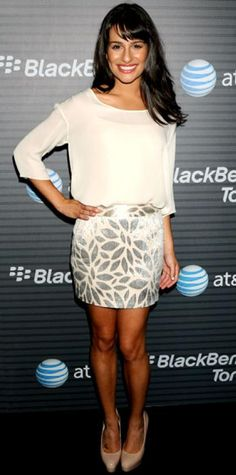 Look of the Day › August 12, 2010 WHAT SHE WORE The Glee star selected a Jenni Kayne outfit and patent Brian Atwood pumps for the L.A. launch of BlackBerry Torch. WHY WE LOVE IT Talk about a high note! Lea Michele added a silver jacquard skirt to a sheer top for a fresh, elegant look.