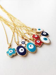 https://www.etsy.com/listing/552149394/evil-eye-necklace-evil-eye-charm Evil eye necklace, evil eye charm necklace, clover charm necklace, evil eye jewelry, evil eye beads, blue evil eye, gold chain necklace #evileye #evileyes #evileyenecklace #evileyecharm #charmnecklace #clovercharm #clovernecklace #goldchain #necklacecharm