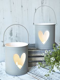 Taupe Heart Hurricane So Scandinavian. This lovely metal hurricane lantern has a heart cut-out & contemporary chalky natural taupe paint finish.  Great centerpieces!