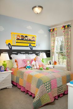 Cute kids bedroom in The Evandale model in Jacksonville, Florida. Love the school bus painted on the wall!