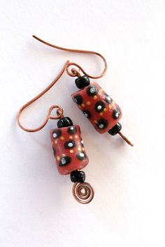 Unique earrings made from Krobo beads. Artisans in Ghana create these beads from recycled glass (bottles, jars) and paint them by hand. Each bead and earring pair is unique. All proceeds go to the SDA School in Ankaase, Ghana to fund the computer lab. $10
