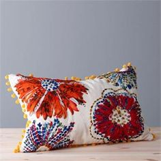 I like the modern saris for cushions as opposed to traditional zari and embroidery.