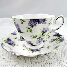 Beautiful bone china tea cup made Royal Albert. Pattern is Lilac Lane Platinum, cup and saucer have small purple flowers (lilacs) all over. Silver colored trimming on cup and saucer edges.  Excellent condition (see photos).  The markings read: Royal Albert Archive Collection Lilac Lane Platinum Bone China Made in England   Please bear in mind that these are vintage items and there may be small imperfections from age or flaws from production. I try to make my photos as clear as possible and…
