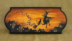 A witch on a broom with her black cat. I want this...