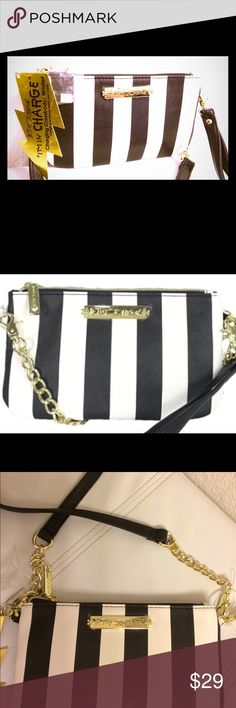 "💕Betsey Johnson Charging Crossbody / Wristlet💕 The intelligent way to carry a smart device. Provides charger for iPhone, Samsung, ...just about every electronic that doesn't use batteries to function. Features credit card slots, pockets, zip-top close & plenty of signature Betsey Johnson flair. 5"" long.  New with tags Betsey Johnson Bags Clutches & Wristlets"