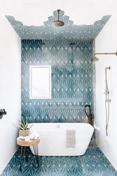 This Kids' Is So Chic That Even Adults Will Be Jealous, boho bathroom with bold tile, bole blue geometric tile in bathroom design with modern slipper tub, modern free standing bathtub in bold modern bathroom, fun kid bathroom design with blue tile