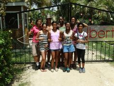 Phase 1 girls from The Passport Party Project pose in front of the gates at Liberty Children's Home in Belize, having donated time and money to this much needed orphanage. #travelwithpurpose [July 2013]