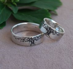 Bands I have designed here are of a beautifully carved tree for my Earth friendly people. SET of 8mm (5/16) wide bands in sterling 1/16th or 1.5mm thick. Lightly oxidized to enhance image. Sizes available are 4.5 to 14.5 If your size is not listed please leave it in the Note from buyer on the checkout page. I also offer this an adjustable ring- open in the back for people with arthritic fingers. For adjustable rings, put the smallest size the ring can be when finished in the note from…
