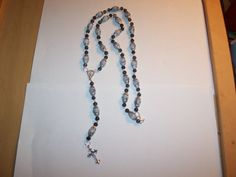 Necklace  its 19 in long  ,8 mm charm  flower Silver Tone Alloy End Caps Beads,6mm Pattern glass crystal beads black with gray in beads ,10mm gray beads with black mix in .silver eye pins,8mm jump ring connectors .cross is  2 in long 1 in wide, virgin Mary center of Rosary   Shop this product here: http://spreesy.com/BlueeyesJewelryShop/114   Shop all of our products at http://spreesy.com/BlueeyesJewelryShop      Pinterest selling powered by Spreesy.com