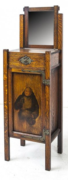 Shop of the Crafters, attribution, oak Arts and Crafts stand with mirror and painted monk.