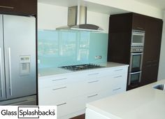 Pale blue glass splashback. We create bespoke glass products in any colour, pattern or image. Whether it's a splash back, worktop or table top, it's possible to personalise your glass to suit your existing decor, or taste. Visit www.glasssplashbacks.com for more inspiration!