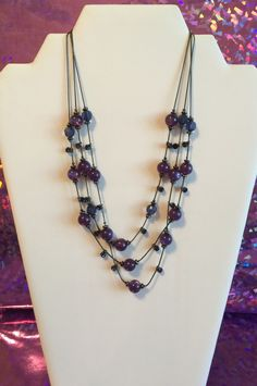 A personal favorite from my Etsy shop https://www.etsy.com/listing/289811695/purple-tones-three-layer-necklace