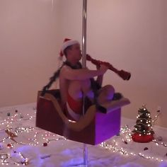 "This Clarinet-Playing Pole Dancer Is the Only Holiday Gift You Need: You may remember pole-dancing clarinet player Paul Groslouis from his amazing rendition of Jason Derulo's ""Wiggle,"" and now he's back with lots of holiday cheer (and a tiny pair of Santa-inspired shorts)."
