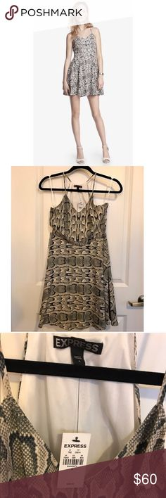 Express Python Print Dress NWT. Hook and zip closure. Extremely flattering dress! 100% polyester. In my opinion, this runs true to size, but please let me know if you need any measurements. Express Dresses