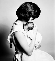 Jacqueline Kennedy holds her son John F. Kennedy Jr.