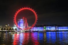 size: Photographic Print: The London Eye, also known as the Millennium Wheel, and the Blue Illuminated County Hall by Jonathan Kingston : Artists Tower Of London, London Bridge, Madame Tussauds, Covent Garden, London Eye, Design Museum, Westminster, Kingston, Natural History