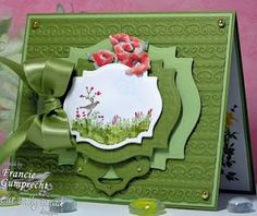 """Spellbinder's Lables 18 Nestabilities were used to cut out and frame the image. I used a pop out flower from a Flower Soft """"Wildflower"""" Kit over the top of the image and a Fleur de Lis Shapeabilitie on the bottom. The background was embossed using a Sizzix E/F. Gold pearls and ribbon were added!"""