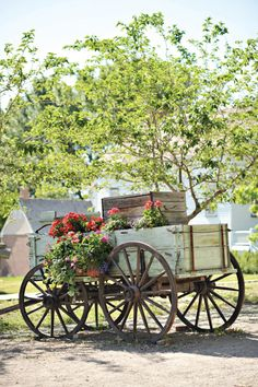 Wagon for the driveway entry..sided with prairie grass...greens, and flowers to the front and flowers on the inside