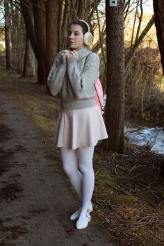 Shop this look on Lookastic:  http://lookastic.com/women/looks/crew-neck-sweater-backpack-skater-skirt-tights-ballerina-shoes/9119  — Grey Crew-neck Sweater  — Pink Leather Backpack  — Beige Skater Skirt  — White Tights  — White Leather Ballerina Shoes