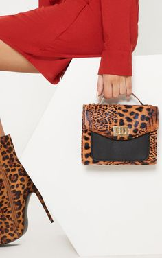 c4c6b14fa2 Insert some leopard print into any outfit with this mini bag. Featuring a leopard  print