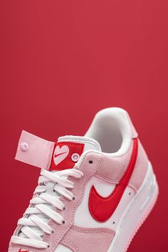 """Wear your heart on your shoes this Valentine's Day with the Nike Air Force 1 Low """"Valentine's Day Love Letter."""" This ode to the lover's holiday is complete with a button design on the tongue that reveals heartwarming branding. Air Force Ones, Air Force 1, Nike Air Force, Valentines Day Love Letters, Your Shoes, White Leather, Baby Shoes, High Heels, Heaven"""
