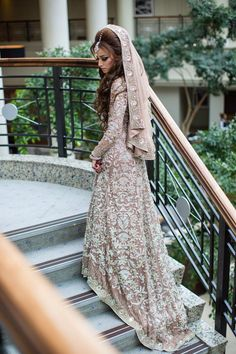 Photo via Naeem Khan east west infusion wedding dress, beautiful long brown wavy hair Check out more desings at: http://www.mehndiequalshenna.com/