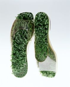 """Sandals """"Barefoot in the Grass"""" Herbert Levine, c. 1968. Surreal and pop sandals. Through the upper made of transparent vinyl you can see the sole covered with artificial grass, and you can imagine at a glance how your feet would feel in this footwear. The synthetic materials which were popular in the 1960s stimulated human bodies optically and haptically with their artificial new textures. Beth and Herbert Levine established Herbert Levine in the U.S.A. in 1958. Their innovative designs brought a fresh sensitivity to shoe design by boldly using synthetic materials such as loafers made of transparent vinyl and boots of stretch materials."""