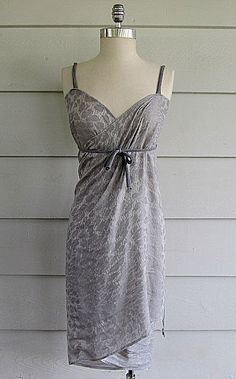 large scarf or sarong --> beach cover-up / informal dress