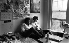 Students looking at album in dorm room. Black and white print (photograph) Alma Mater, Dorm Room, Candid, Have Fun, Students, Photograph, Album, Lettering, Dormitory