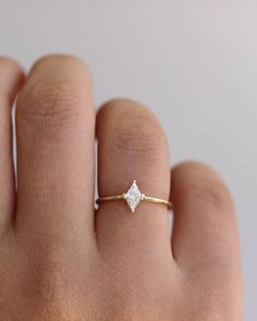 This unique, dainty ring pairs perfectly with additional rings to sparkle in the light. Dream Engagement Rings, Engagement Ring Cuts, Vintage Engagement Rings, Minimalistic Engagement Ring, Simple Diamond Ring, Dainty Ring, Diamond Rings, Emerald Rings, Cute Jewelry